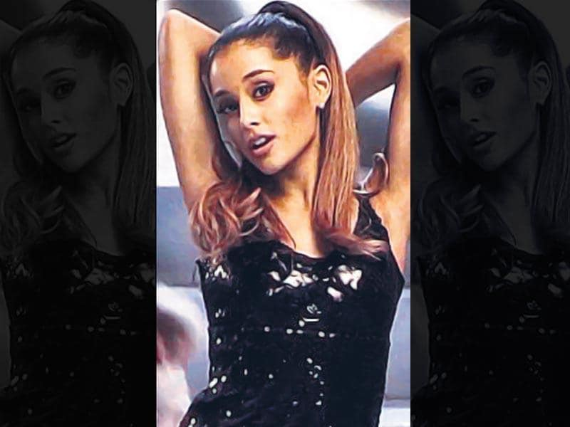 Ariana Grande in Problem: That ponytail: We just might do a double take if we spot Ariana without her favourite, tumbling ponytail which of course, totally ruled this video. If you, too, are blessed with lengthy tresses, you've got to try the oh-so-glamorous waterfall ponytail.