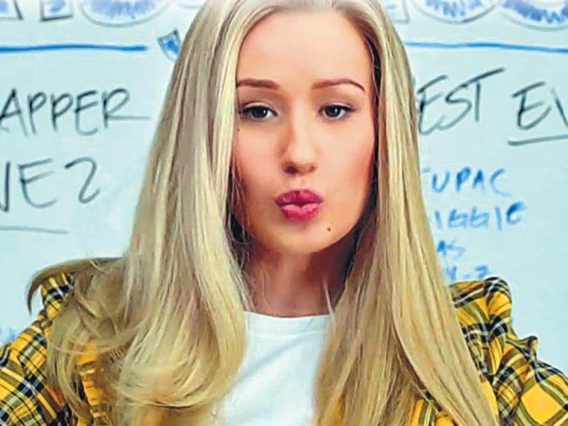 Iggy Azalea in Fancy: 'Clueless' chic: Remember the iconic 1995 movie, Clueless? Iggy's look in the video seems like an update on the 'rich kid' high school style from the film. We love the clean makeup and the enviable long locks that spell all-business.
