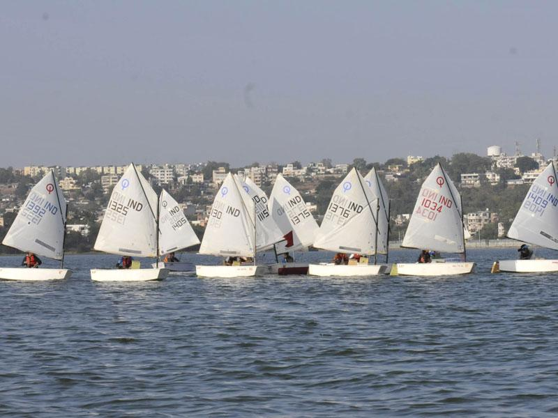 Sailors compete in the National Inland Optimist Sailing Championship 2014, at Upper lake in Bhopal, on Saturday. (Mujeeb Faruqui/HT photo)