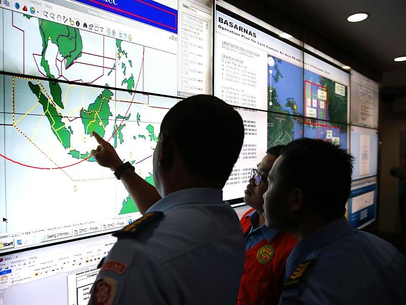 Military and rescue authorities monitor progress in the search for AirAsia Flight QZ8501 in the Mission Control Center inside the National Search and Rescue Agency in Jakarta. (Reuters)