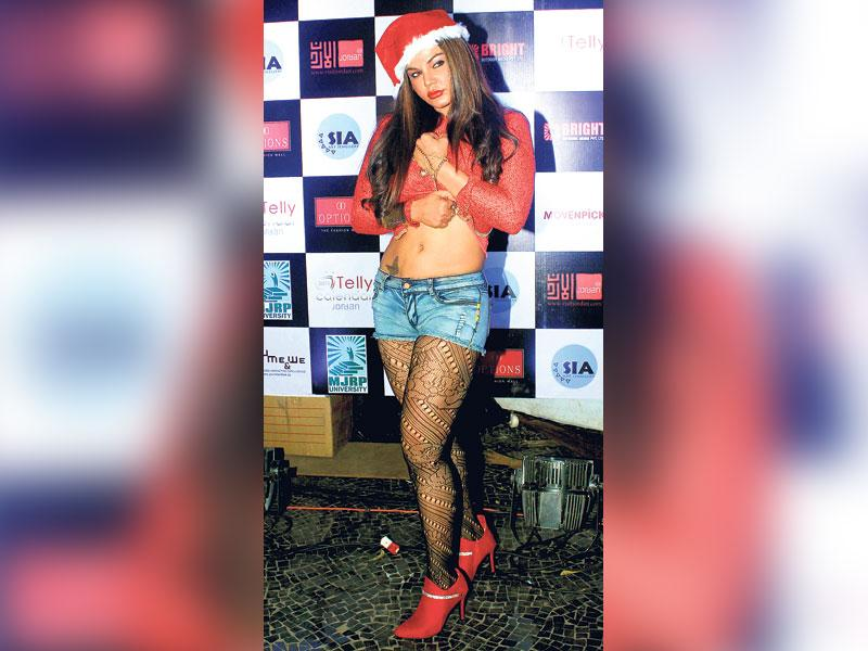 The ugly: Rakhi Sawant at a Mumbai event on December 23OURTAKE: Santa Rakhi's gift to herself this Christmas should be a brand new stylist.