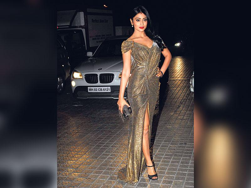 The good: Shriya Saran at a film screening on December 23OURTAKE: The gown fits Shriya like a dream, and we love the styling - red lips for all-out glamour, and black sandals to balance the look out.
