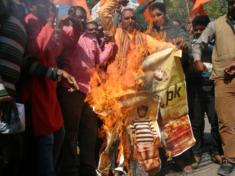Bajrang Dal activists protest against the screening of 'PK' at Jyoti Talkies in Bhopal on Monday. (Bidesh Manna/HT photo)