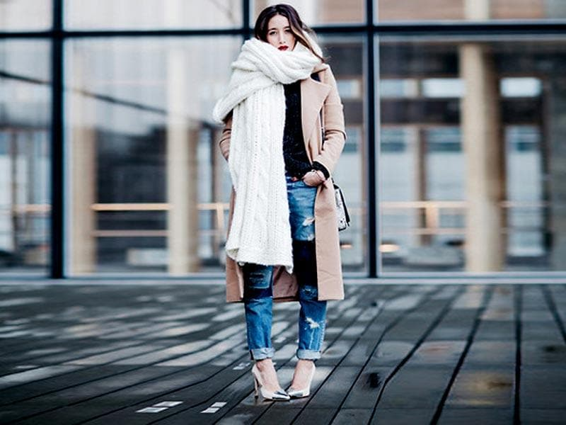 The latest fashion trends in winter style indicates that if your jacket is of white, cream, grey, black or any other solid colour then you should have a stole or scarf on it of the light color. Try something like this look to stay fashionably warm this season. (AFP)