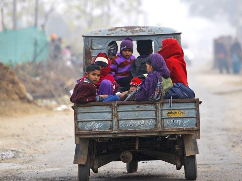 Villagers sit in a vehicle as they flee their homes fearing firing from the Pakistan side, in Samba sector. (AP Photo)