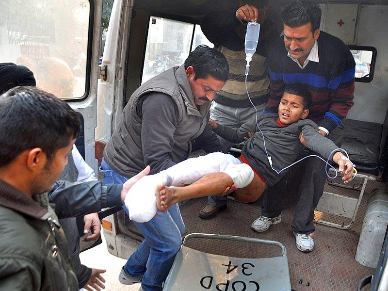 Rahul Kumar, injured in cross-border firing between Indian and Pakistan troops, shifted to Government Medical College Hospital in Jammu. (AFP Photo)