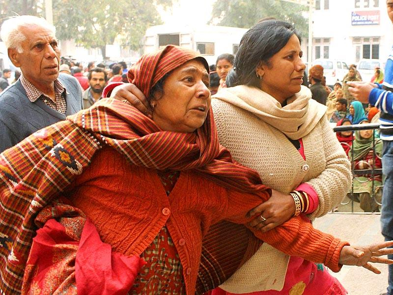 Family members of an injured civilian react near the Government Medical College and Hospital in Jammu on Saturday. (PTI Photo)
