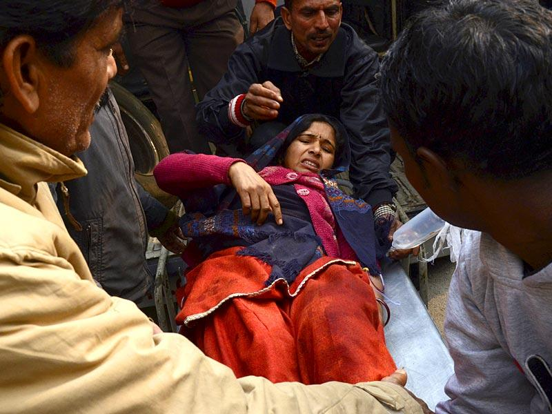A lady injured in cross-border firing is shifted to Government Medical College Hospital in Jammu. (Nitin Kanotra/HT Photo)