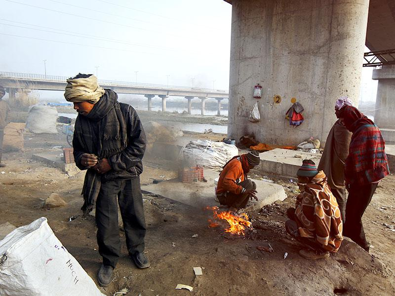 Winters are particularly the harshest of months for the homeless in the capital, especially if one finds refuge near the river Yamuna. People migrate here looking for a livelihood but end up jobless competing for limited resources while a constant migration puts a strain on the capital's shrinking space. (Subrata Biswas/HT Photo)