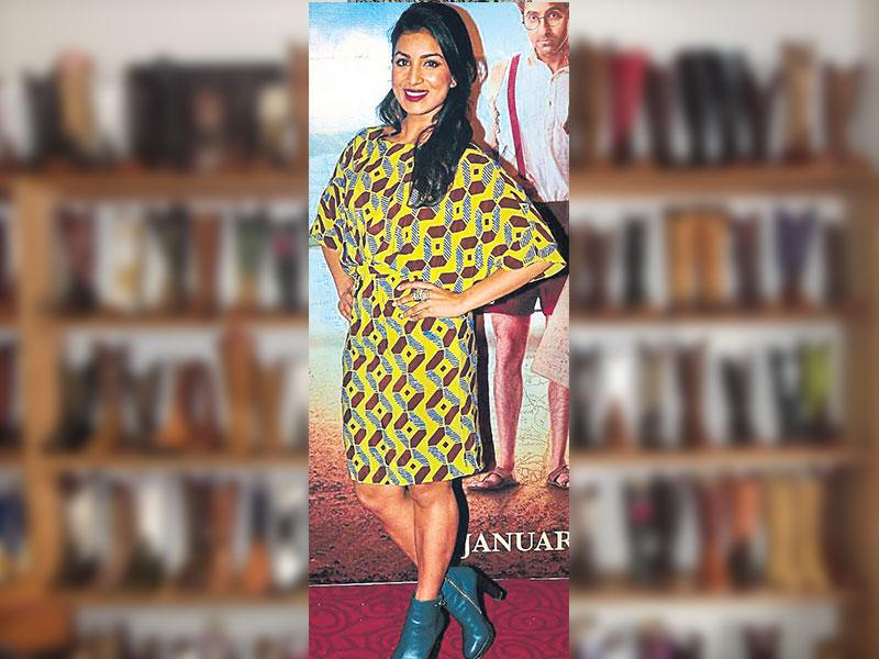 Actor Pallavi Sharda paired her yellow printed dress with a pair of blue ankle booties.