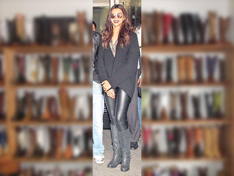 Deepika Padukone paired her leather pants with black boots.