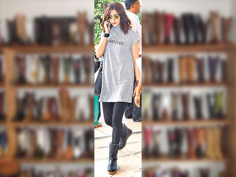 Anushka Sharma in fleece lined leather boots.