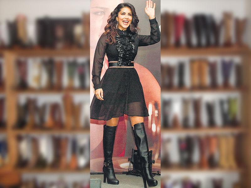 Actor Sunny Leone paired her thigh high boots with a sheer little black dress. (Text: Torsha Sen/ Photo: Yogen Shah)