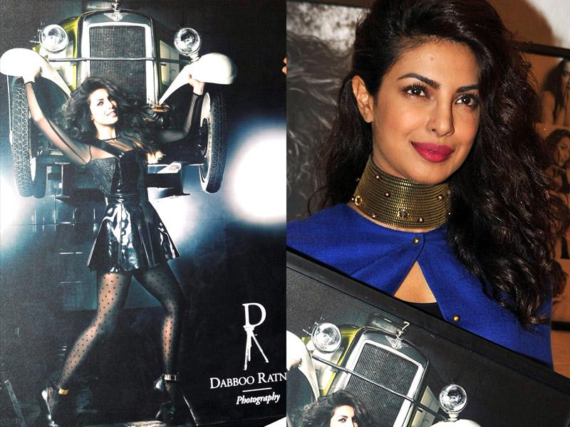 Mary Kom actor Priyanka Chopra was seen in a blue cape and choker necklace at the event. She happily posed for the shutterbugs holding her calendar photo- a sexy siren in black.