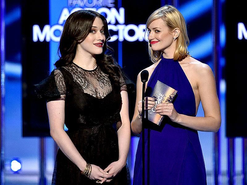 Actors Kat Dennings (L) and Beth Behrs speak onstage. (AFP Photo)