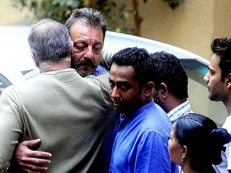 Sanjay Dutt hugs a relative as he prepares to return to the Yerwada Jail after the end of his furlough in Mumbai on January 8, 2015. (AFP Photo)