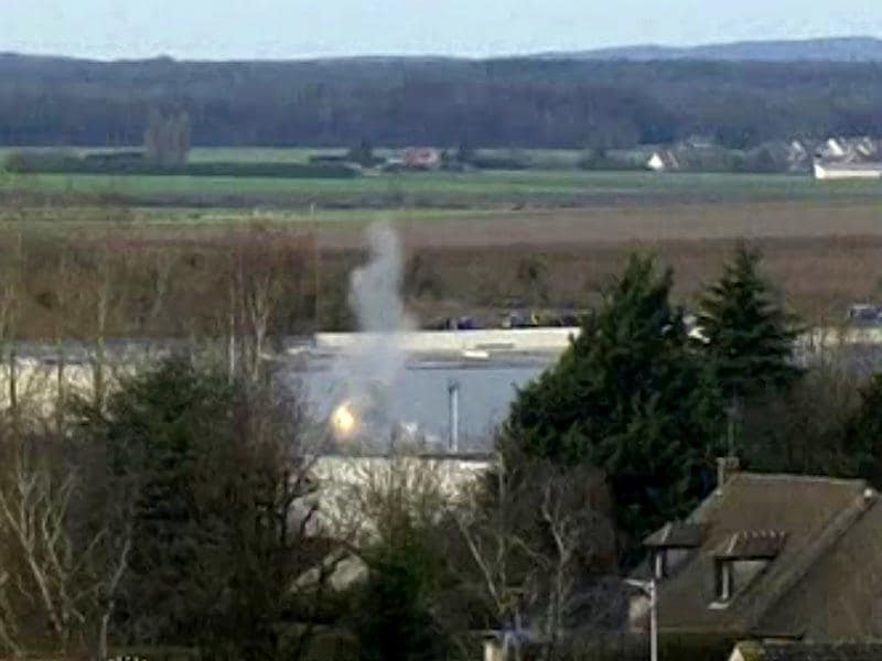 A flash of light and smoke appear, in this video grab, at the start of the final assault at the scene of a hostage taking at an industrial zone in Dammartin-en-Goele, northeast of Paris. (Reuters)