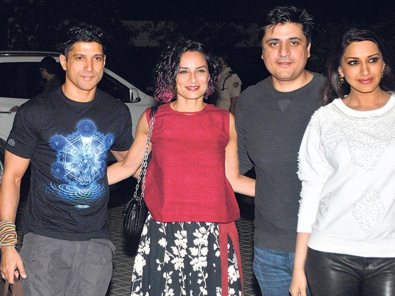 Farhan Akhtar and wife Adhuna are joined by Sonali Bendre and her husband Goldie Behl. (HT photo)