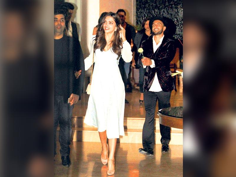Filmmaker and ­choreographer Farah Khan's 50th birthday bash in Mumbai saw the who's who of Bollywood. Actor Ranveer Singh was at his goofiest best, ­following rumoured girlfriend Deepika Padukone with a rose as she walked ahead with filmmaker Karan Johar. (HT photo)