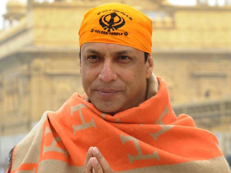 Filmmaker Madhur Bhandarkar poses for a photograph during a visit to the Golden tTmple in Amritsar on January 10. (AFP Photo)