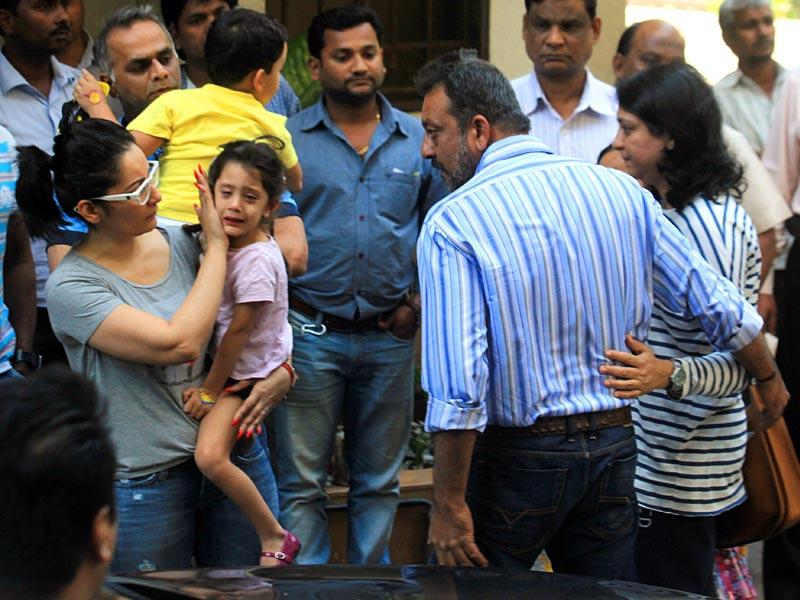 Bollywood actor Sanjay Dutt's daughter cries while bidding farewell to him. Wife Manyata and sister Priya along with Dutt as he leaves his residence at Bandra to return to jail after Yerwada Prison authorities rejected his plea for the extension of his furlough, in Mumbai on Saturday, January 10, 2015. (Photo by Kunal Patil/ Hindustan Times)