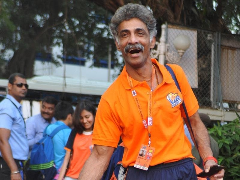 Bollywood actor Makrand Deshpande arrives for the Celebrity Cricket League (CCL) season five in Mumbai on January 10, 2015. (AFP Photo)