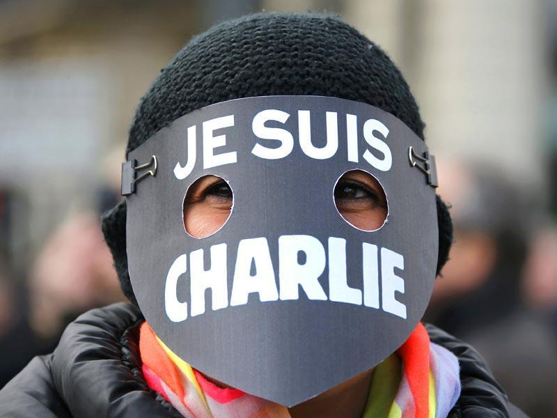 A woman wearing a mask reading 'I am Charlie' takes part in a solidarity march (Marche Republicaine) in the streets of Paris. (Reuters Photo)