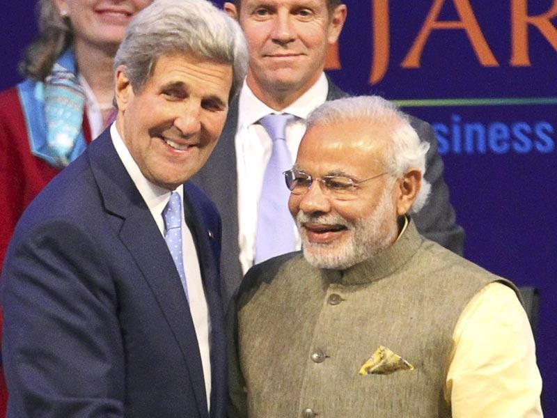 US secretary of state John Kerry and Prime Minister Narendra Modi attend the Vibrant Gujarat summit in Gandhinagar. (AP photo)