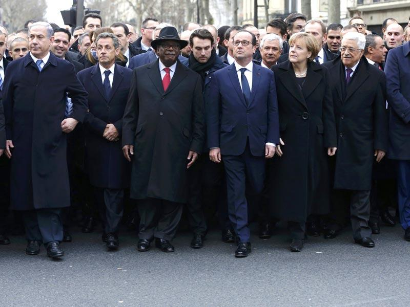 French president Francois Hollande is surrounded by head of states including (L to R) Israel's prime minister Benjamin Netanyahu, former French President Nicolas Sarkozy, head of the French conservative party UMP party, Mali's President Ibrahim Boubacar Keita, Germany's Chancellor Angela Merkel, Palestinian President Mahmoud Abbas and Italy's Prime Minister Matteo Renzi as they attend the solidarity march (Marche Republicaine) in the streets of Paris. (Reuters)