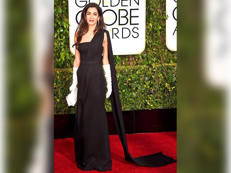 Amal Clooney: The awards season debut of George's bride was much anticipated. Her long, baggy white gloves with a black Dior Haute Couture one-shoulder gown and long Harry Winston earrings had lots of fingers tweeting.