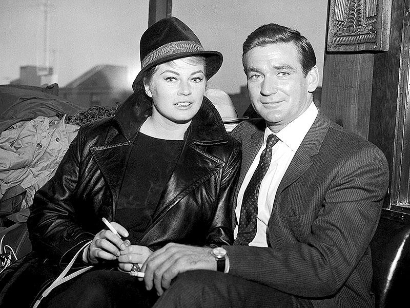 In this May 9, 1962 photo, Swedish actor Anita Ekberg and Australian-American actor Rod Taylor, who plan to marry soon, in San Francisco, United States. Anita Ekberg, the Swedish-born actor and sex-symbol of the 1950s and '60s who was immortalized bathing in the Trevi fountain in La Dolce Vita, has died. She was 83. Ekberg's lawyer Patrizia Ubaldi confirmed her death Sunday, January 11, 2015. (AP)