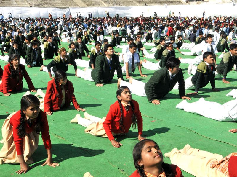 School children dress-up like Swami Vivevkananda during a programme of mass Surya Namaskar at a government school in Bhopal on Monday. (Praveen Bajpai/HT photo)