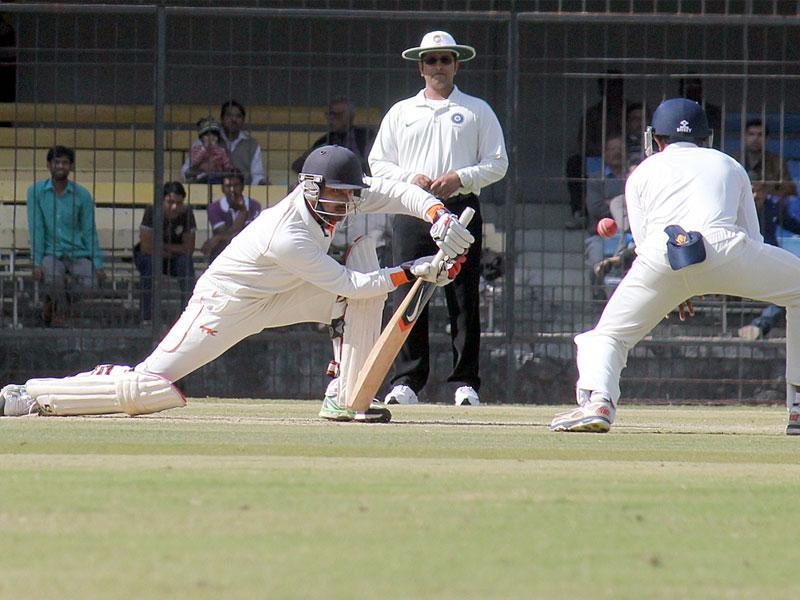 MP opener Aditya Shrivastava in action on the opening day of Ranji trophy match against Karnataka at Holkar Stadium in Indore on Tuesday. (Shankar Mourya/HT photo)