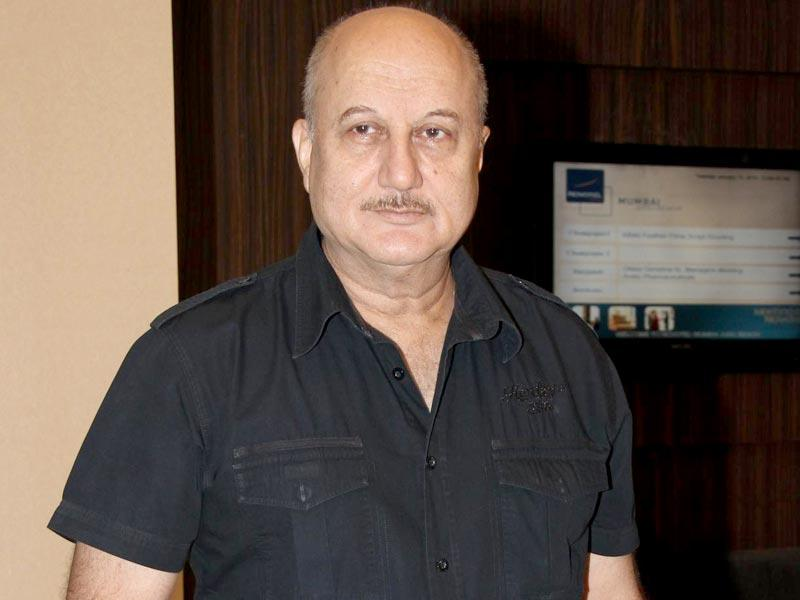 Anupam Kher and actor Aishwarya Rai Bachchan during the script reading session of film Jazbaa in Mumbai, on Jan 13, 2015. (Photo: IANS)