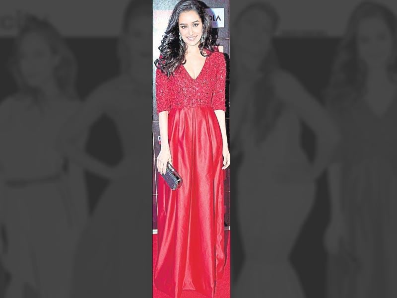 We couldn't help but notice that Shraddha Kapoor's blingy red gown has that classic old world charm.