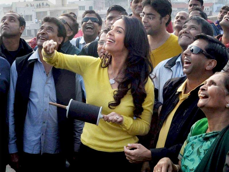 Bollywood actor Mallika Sherawat enjoying kite fly on the occasion of Makar Sakranti in Jaipur on Wedesday. (PTI Photo)
