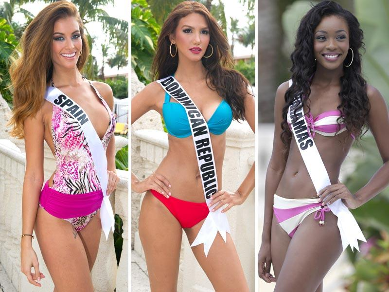 Left to right: This picture provided by the Miss Universe Organization shows Miss Spain Desire Cordero Ferrer, Miss Dominican Republic Kimberly Castillo and Tomii Culmer of the Bahamas posing during the Miss Universe 2015 swimsuit fashion show in Miami (AFP and AP)