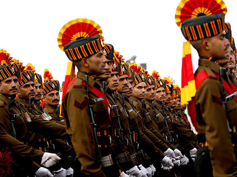 Army men march to receive an award (sena medal) during the Army Day parade in New Delhi. (HT photo)