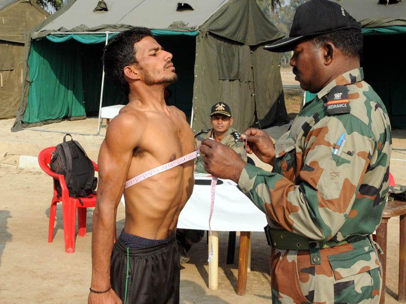 An army man measures the chest of a youth during the recruitment rally in Patiala on Friday. Bharat Bhushan/HT