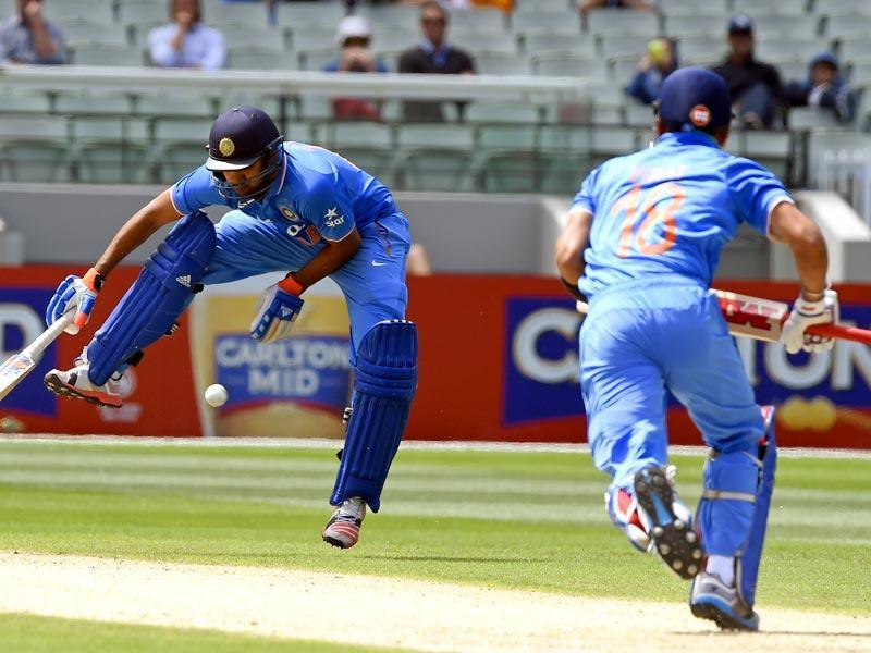 India's Rohit Sharma, left, jumps over the ball hit from team mate Virat Kohli, right, during their One Day International cricket match against Australia in Melbourne. (AP photo)