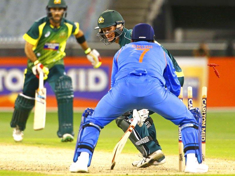 Australia's George Bailey is stumped for five runs by India's wicketkeeper MS Dhoni during their one day international tri-series cricket match at the Melbourne Cricket Ground in Melbourne. (Reuters)