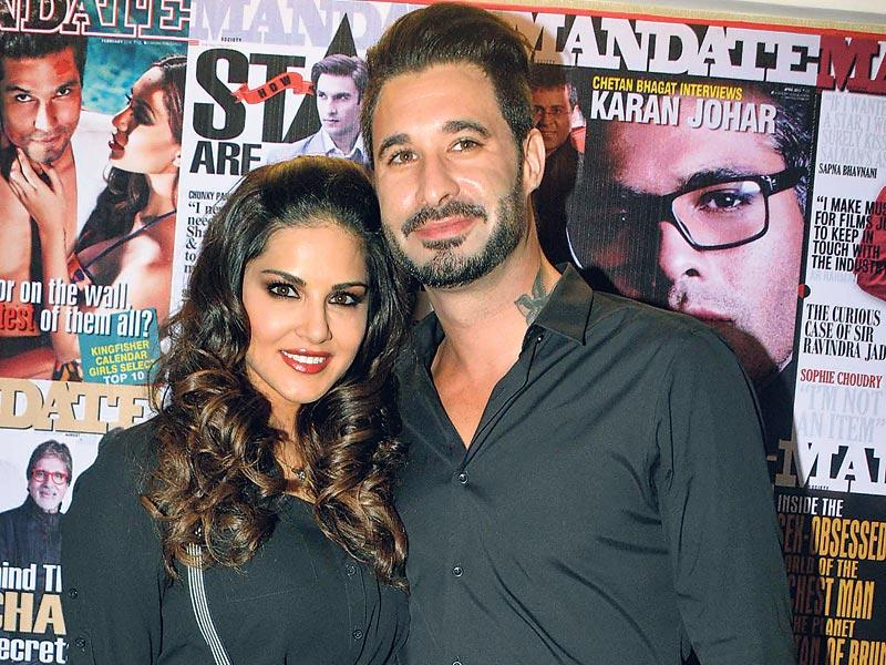 Sunny Leone poses for the shuterbugs along with husband Daniel Weber. (Photo: Viral Bhayani)