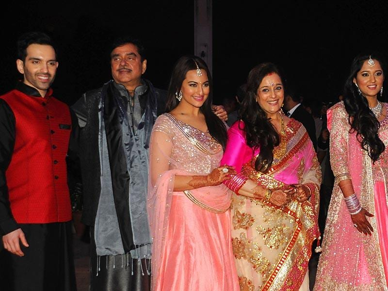 The family that poses together... Shatrughan Sinha with his wife Poonam, pose with children Luv, Sonakshi and daughter-in-law Taruna. (AFP)