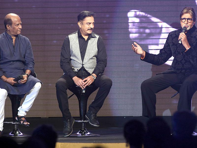 Amitabh Bachchan speaks to the audience with Rajinikanth (left) and Kamal Hassan during the music launch of Shamitabh in Mumbai. (AP Photo)