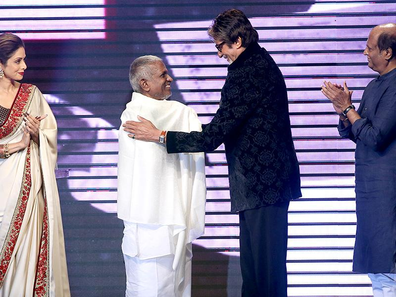 Bollywood actor Amitabh Bachchan talks with music director Ilaiyaraaja (centre) as actors Sridevi (left) and Rajinikanth (right) look on during the music launch of Shamitabh in Mumbai.(AP Photo)
