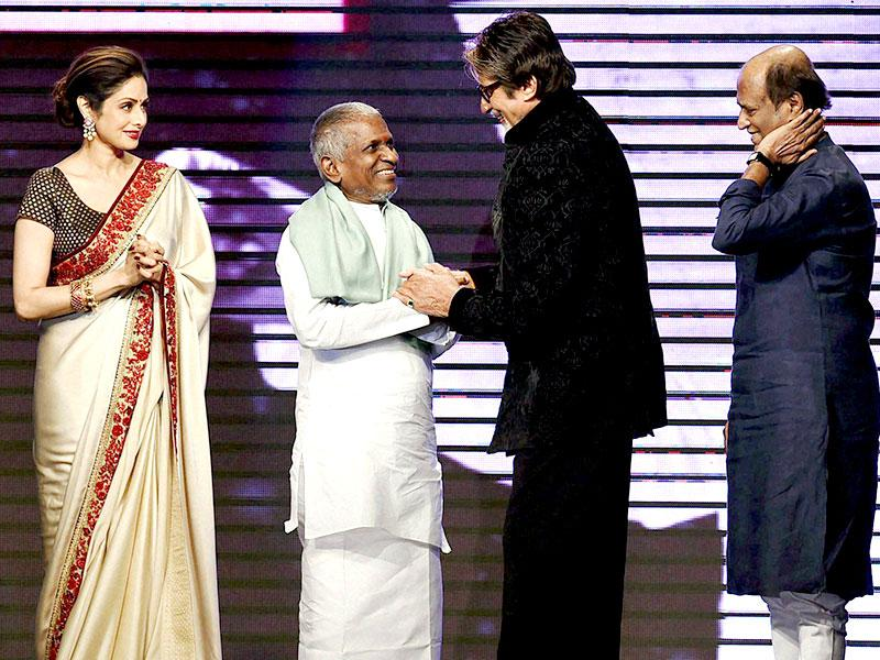 Amitabh Bachchan felicitates music director Ilaiyaraaja as Sridevi, Rajinikanth and Kamal Haasan look on during the music launch of Shamitabh in Mumbai on January 20, 2015. Shamitabh is Ilaiyaraaja's 1000th movie. (AFP Photo)