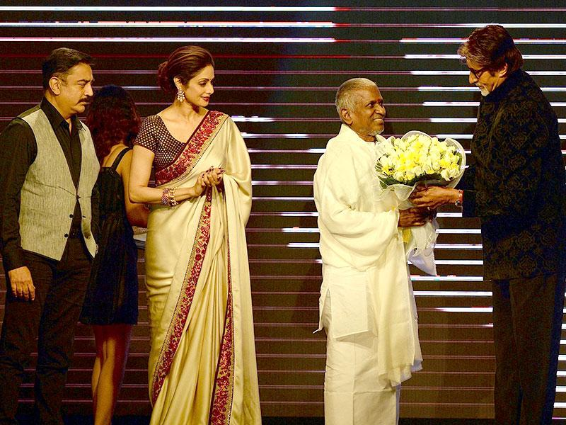 Sridevi along with actors Kamal Hasan, Rajnikanth and Amitabh Bachchan felicitate music director Ilayaraja during the music launch of Shamitabh, that marks 1000th movie of the musician, in Mumbai on Tuesday. (PTI Photo)