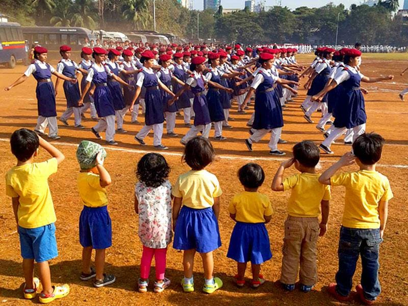 Kids from a playschool in Mumbai salute as they watch other school children participating in a Republic Day parade rehearsal in Dadar. (Kalpak Pathak/HT photo)