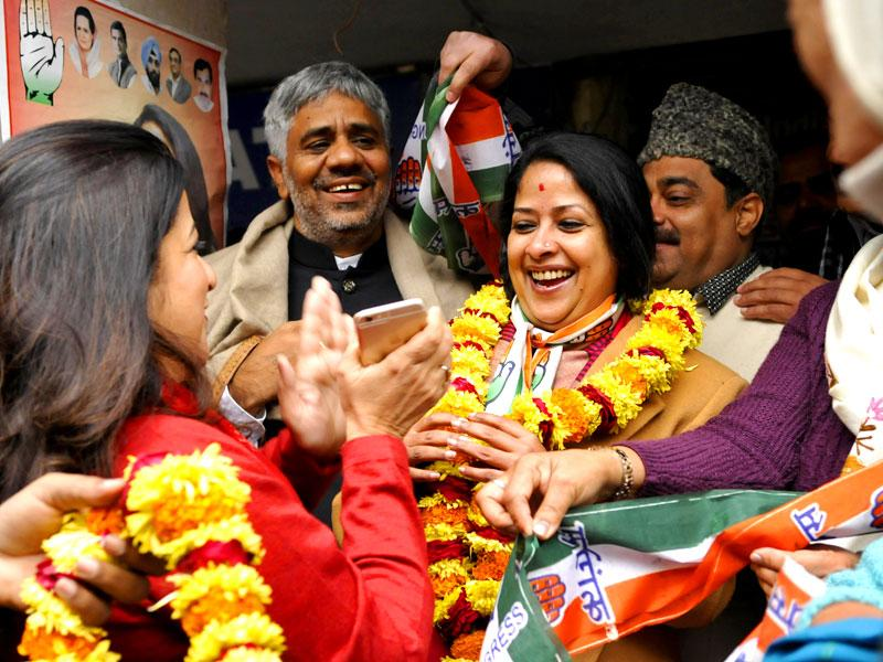 Party workers celebrate at the office of Sharmishtha Mukherjee (C), daughter of the President of India, Pranab Mukherjee. Sharmistha is a Congress candidate from Greater Kailash constituency for the upcoming Delhi Assembly Elections 2015. (Saumya Khandelwal/ HT)
