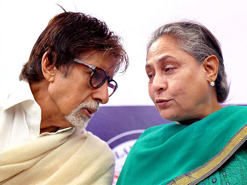 Amitabh Bachchan and Jaya Bachchan caught in sharing a candid moment at the launch of an advance technology in eye care in Mumbai on Wednesday. (PTI Photo)
